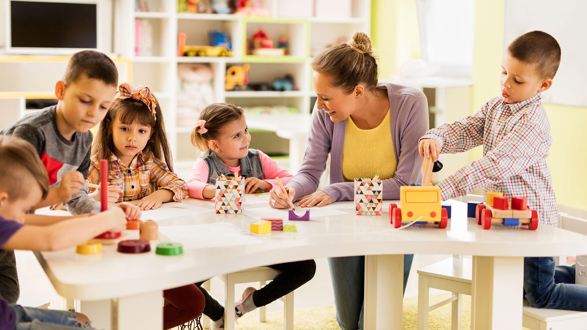 Teacher working with children in classroom