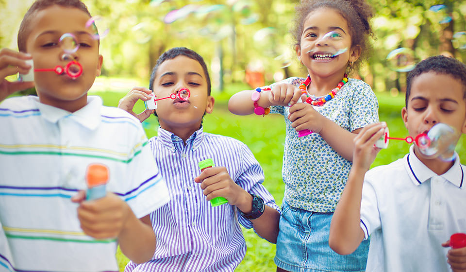 Summer camp kids blowing bubbles